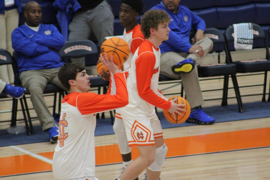 Prior to tipoff, NC varsity players Alex Acosta, Tyler Gorsuch and Sean Haliburton warm-up to prepare for the top-ranked Indians. Despite a trio of three-pointers from Gorsuch, the Warriors ultimately fell 79-66. The Warriors hope to get back on track with a win over the Marietta Blue Devils on Tuesday, December 17.