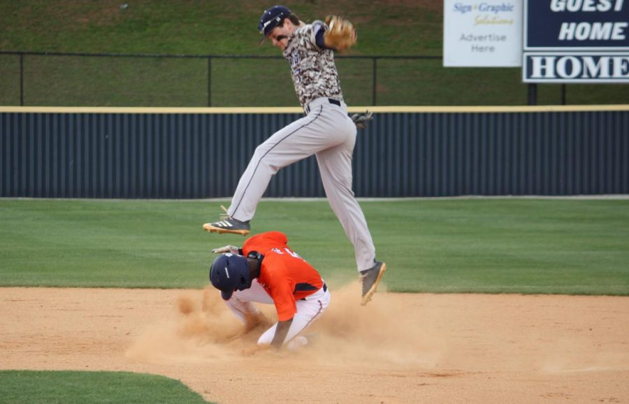 "Magnet senior Josh Dixon slides into second in the 2019 playoff game against the Newnan High School Cougars. Despite impressive plays from the entire team, the Warriors, unfortunately, got knocked out of playoffs after this first game, however, this year the Warriors plan on improving all aspects and coming back with vengeance. ""I actually don't think we had major weaknesses or strengths. We were generally good in all areas, but when it comes to our regions and Georgia baseball in general, 'generally good' is only going to get you so far,"" Assistant Coach Micheal Turchan said."