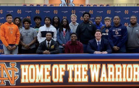 NC Varsity football players (pictured left to right) Malik Washington, Kalen Carver and Joshua Kimmons wear colors that represent the universities they officially signed to. Their football team surrounds and support the seniors as they begin preparing to take the next step to further their career.