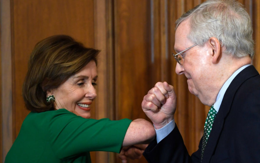 Pelosi and McConnell elbow in Washington after coming to an agreement and how Congress will respond to the COVID-19 crisis. After failed attempts the two celebrate. The House plans to vote on Friday.