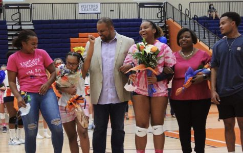 Escorted by her parents and three siblings, Senior setter Kayla Johnson laughs with her family during an event she has eagerly awaited since joining the varsity team her freshman year. Over the course of her NC volleyball career, she won two AAU club tournaments and received the title of GACA Junior All Star when she recorded 101 aces throughout the duration of her junior season. After graduation, Johnson plans to pursue cosmetology while majoring in business.