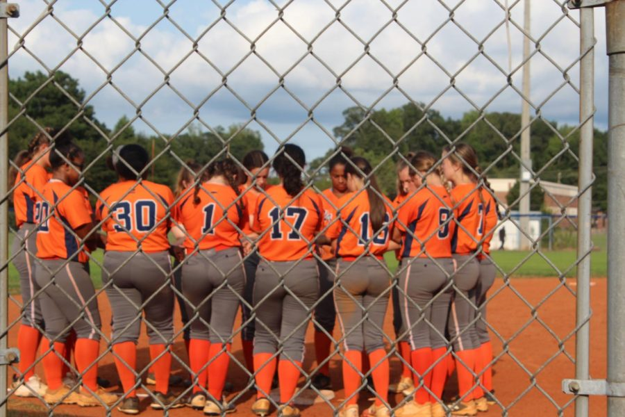 "The NC Lady Warrior softball team huddle around 3rd base and pray before and after each game, followed by a chant to lift their spirits. ""Praying and just talking to each other before each game gets us excited to go play. It kinda relieves some of the pressure we're under,"" junior Mackenzie Ogburn said."