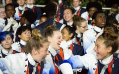 """Marchers will no longer be seen in their uniforms when attending games; instead they wear khakis and a blue, dry fit t-shirt. """"Just last year all of us were joking around and having fun, practicing for competitions and laughing in the stands at football games. It's crazy how things changed so fast,"""" NC sophomore Addie Quintana said."""