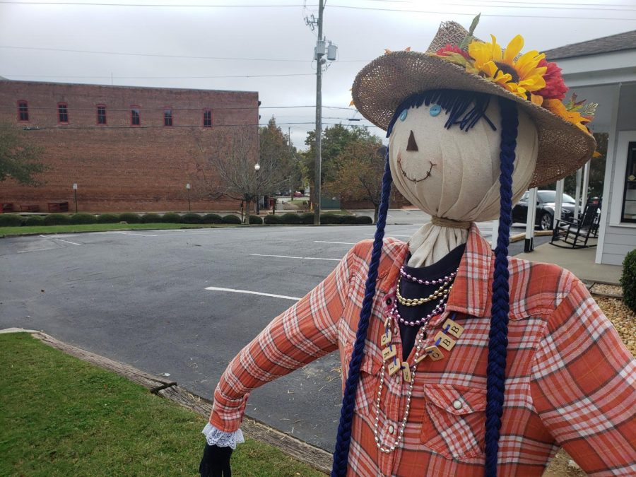 A+scarecrow+stands+in+downtown+Kennesaw+as+part+of+the+Scarecrows+on+Main+event%2C+and+while+Halloween+draws+ever+closer%2C+families+look+for+Covid-safe+activities+to+celebrate+the+holiday.+%E2%80%9CHalloween+is+my+favorite+holiday%2C+and+I+was+feeling+a+little+concerned+that+this+year+we+might+have+to+skip+on+it.+Luckily+our+community+is+coming+together+to+make+sure+Covid+doesn%E2%80%99t+put+a+damper+on+celebrations%2C%E2%80%9D+Kennesaw+Mountain+sophomore+John+Davis+said.