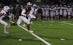 NC sophomore quarterback Malachi Singleton charges down the field cradling the ball in hopes of securing a touchdown for the NC Warriors. Singleton, tailed by Walton senior Austin Eldred and junior Cade Thompson, eventually scored multiple touchdowns proving himself once again as an asset to the NC Warrior team.