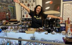 Pictured above, Deb Currans stands behind the front counter of her store, Starstuff, in Downtown Acworth; where she sells jewelry, clothes, and many other unique treasures. The glass case in front of her contains personally wrapped gems, each of which she made beautifully with care.