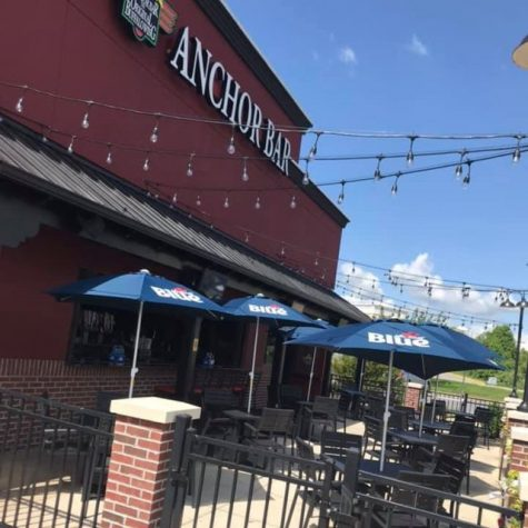 The lively atmosphere of Anchor Bar juxtaposed with live entertainment can be enjoyed outside or inside with versatile seating. The restaurant also hopes to expand on the restaurant and allow guests to play cornhole and other activities while dining.