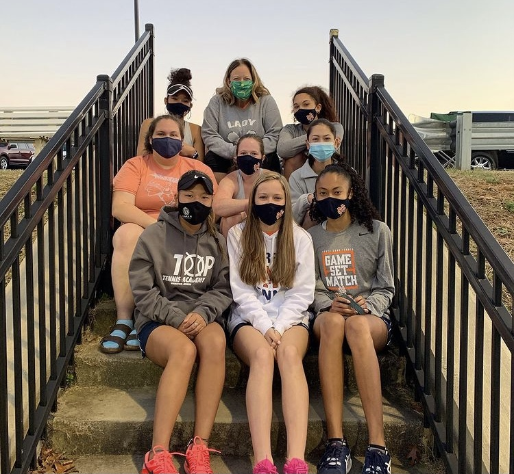 The NC Lady Warrior tennis team collected a 5-1 record during the month of February. Despite getting their season cut short due to the COVID-19 pandemic, the Lady Warriors hold high expectations for this season and the years following. Coach Andrea Drake (pictured top middle) constantly reminds her team to play their game and practice strong mental toughness. With strong players for both the singles and doubles lines, NC looks to add an additional region championship to their name.