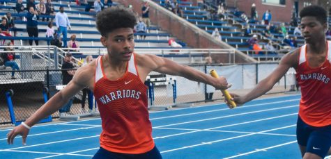 "Sophomore Ben Trelles passes the baton to sophomore Jason Keys, the last runner on NC's team in the varsity boys 4x400 meter relay. While the team did not place high enough to continue to sectionals, coaches and team members remain hopeful for the future. ""We have  a good group of young kids and our older kids have provided leadership, good leadership, like how we expect things to be done around here. The program has grown leaps and bounds in the seven years since I"