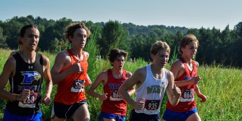 """Magnet senior Bentley Huff runs his race, competing against other runners in the fastest boys time bracket. As a fourth year runner, Huff witnessed the team's evolution over the years. """"I definitely think the culture is a little different, because my first two seasons we were in a different region and we were always in state contention. Last season was a wake up call, because we got put in a much harder region, so last season was kind of rough on all of us and we kind of all went into a bad mentality, but I think this season is definitely better and we at least have a chance,"""" Huff said."""