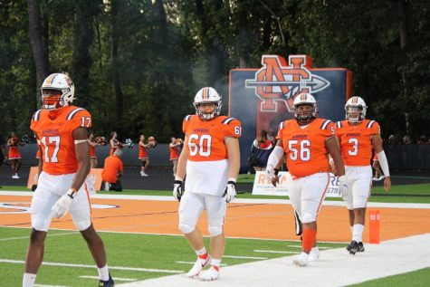 The NC Warriors ventured into their third regular-season game with hopes for a quality win. Led by team captains (pictured left to right) Josh Jospehs, Joshua Bagley, Latrell Bullard, and Malachi Singleton, the Warriors dominated the Alpharetta Raiders by a score of 43-7. With 322 passing yards, Singleton and the offensive unit put up a frenzy of touchdowns that proved NC as a dominant force in this year's 7A class. The Warriors return on Friday, September 17. To take on the Etowah Eagles in a Cobb-Cherokee matchup.