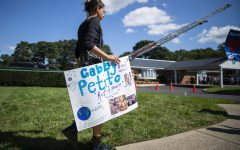 """On September 26th, hundreds of mourners congregated in Holbrook, New York to pay their respects to Petito. Fire trucks positioned themselves on either side of the funeral home as everyone filed into the building. Posters also hung from a chain link fence adorned with pictures of Petito and messages, focusing on one primary statement made from her aunt in a letter: """"She touched the world."""""""